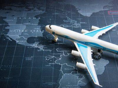 Passenger plane on the world map.Business transportation system concept
